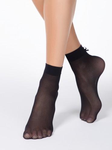 Dichte fishnet sokken voor dames met strikje achter